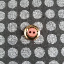 SMALL PINK AND GOLD BUTTON